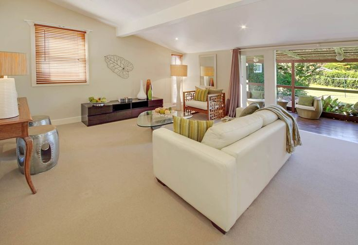 Raked ceiling in this styled lounge space.