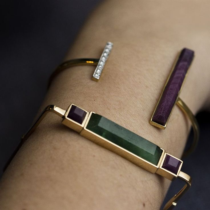 Jade Jagger sure knows how to work a stone - these bracelets incorporate a long rectangular emerald and ruby, set perfectly into yellow gold.