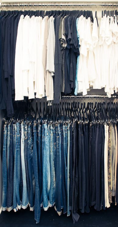 The Coveteur - closets - hang jeans, how to hang jeans, hang your jeans, hanging jeans, color coded closet, closet organized by color, Stac...