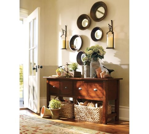 small entryway idea for the new home basket under the entryway table for items such as umbrellas purse etc