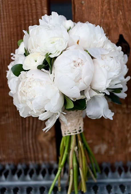 Brides.com: 20 Ways to Wrap a Wedding Bouquet. Take Up Crochet. An antique-dyed piece of crocheted lace looks lovely when wrapped around long, lush stems of an all-white peony bouquet. This rustic wrap works well with any single-bloom bouquet, but peonies are especially lovely.  See more peony wedding bouquets.