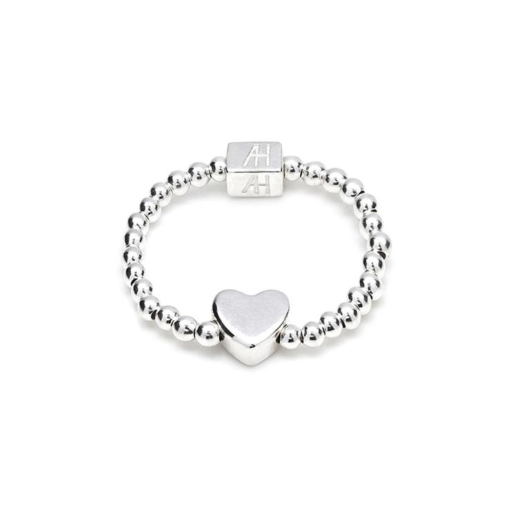 This Tiny Boxed Heart sterling silver ring is a delicate hand-beaded must have accessory. Team this up with our Anna Bella Boxed Heart charm bracelet