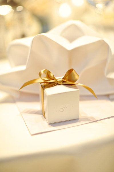 Favour alternative Embossed paper box, tied with a bow - champagne truffle inside #rockmywinterwedding @Derek Imai Smith My Wedding