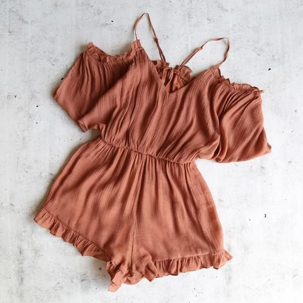 This amazing romper features adjustable straps, a v-neckline, elastic waist, peek-a-boo shoulders and is fully lined at body. - dry clean recommended - hand wash cold - lay flat to dry - iron low if n