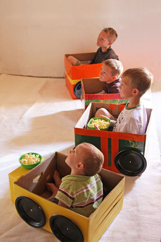Drive in movie theater cars for family movie night. Made from cardboard
