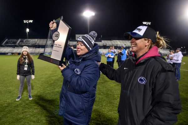 GOPSUSPORTS.COM PHOTO CENTER: Director of Athletics, Sandy Barbour presents the Big Ten Championship trophy to Erica Dambach after the Nittany Lions defeated the Ohio State Buckeyes, 2-0. With the win the Nittany Lions captured at least a share of their 18th Big Ten regular season title. Photo by Mark Selders