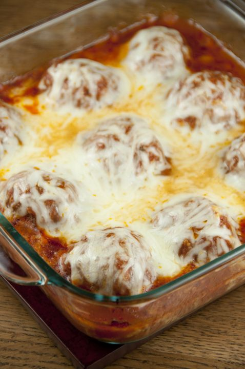 Cheesy meatball parmesan with tomato sauce baked in the oven - no mess or frying! Good enough for a fancy dinner to serve for a holiday or dinner guests.