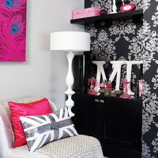 Modern teen room balancing multiple patterns with cool gray, black & hot pink.