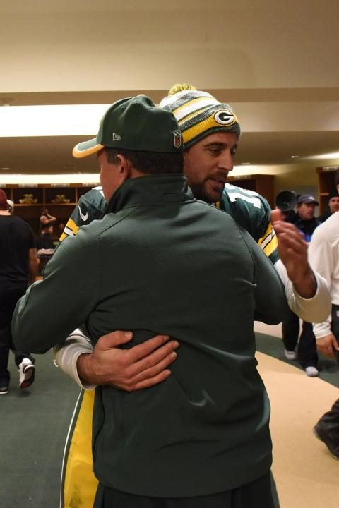 Rodgers getting a hug from Dom Capers 1/11/2015