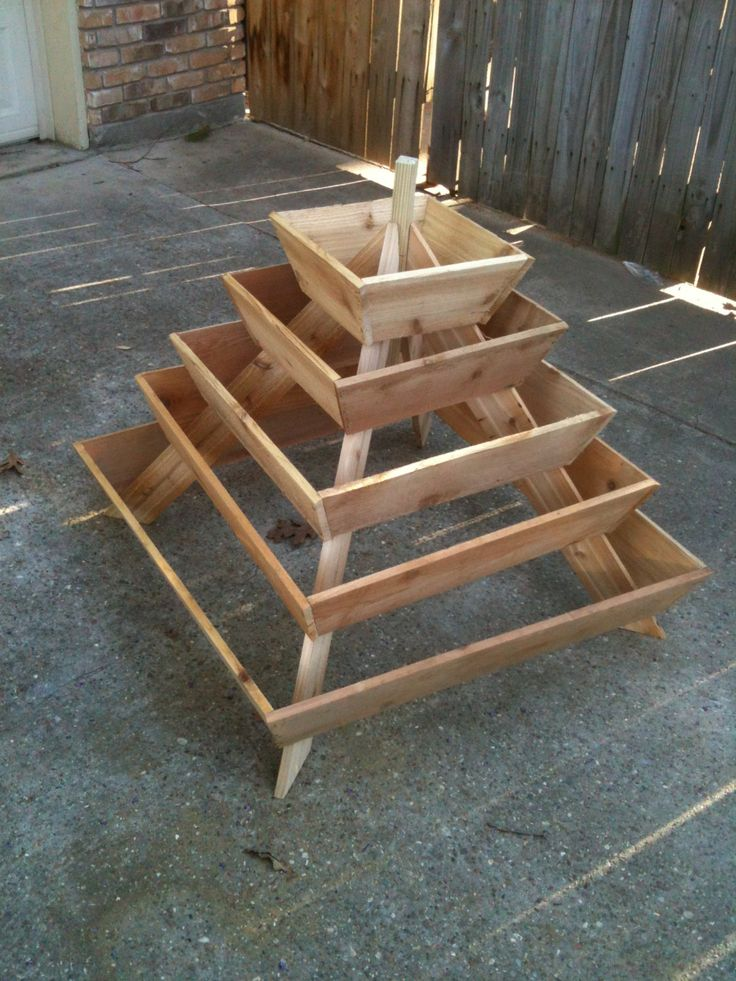Pyramid Planter, herb garden, strawberry planter, vertical planter. This is awesome for a small space! Made by HamerCrafts on etsy!