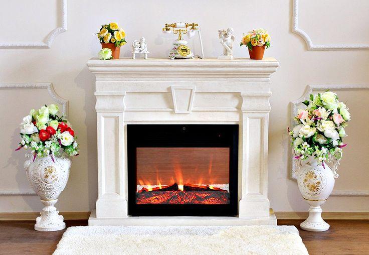 Белый камин, работающий от электросети, обогревает комнату и создает уютную атмосферу; у него, как и у классического, имеются достоинства и недостатки.