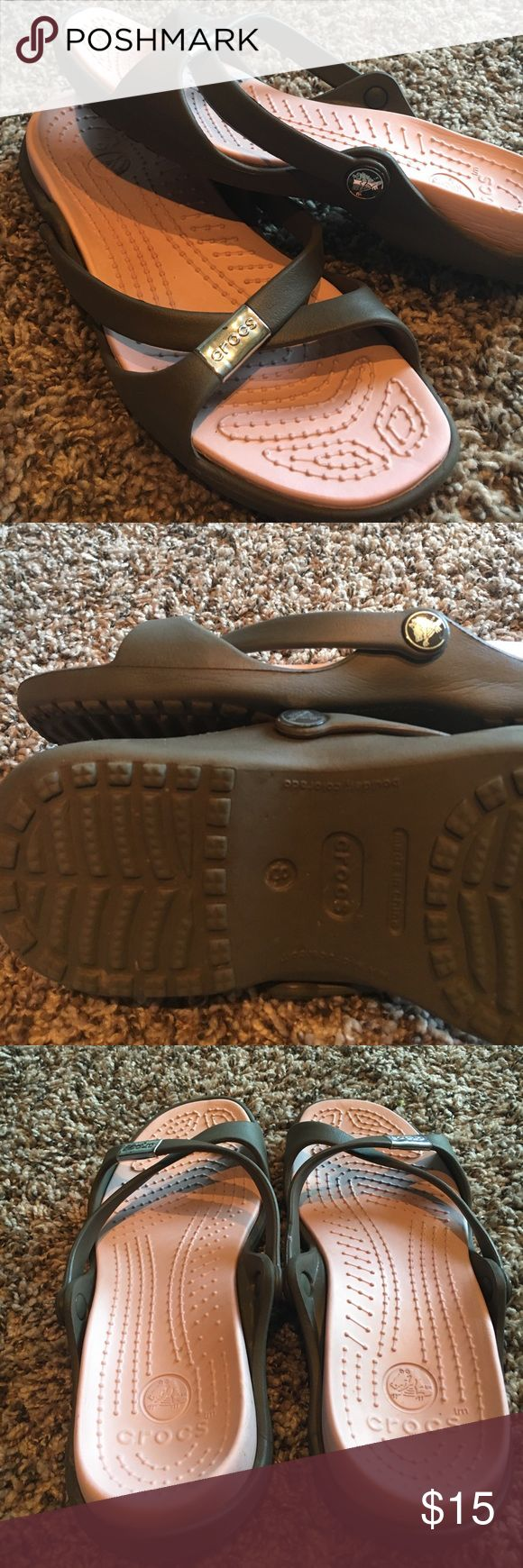 Size 8 strappy CROCS sandals Gently worn, excellent condition, only flaw is some paint/ plastic coating is chipping off the CROCS label on the strap- see last 2 pictures. smoke free. 🛍Open to reasonable offers ONLY please! I will not consider unreasonable offers that are half the asking price. No trades. No Modeling. And please keep in mind Poshmark sets the $6.49 flat rate shipping. Thank you!☺ CROCS Shoes Sandals
