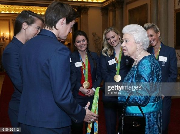 British Olympic womens hockey team players react as they talk with Britain's Queen Elizabeth II during a reception for Team GB's Olympic and...