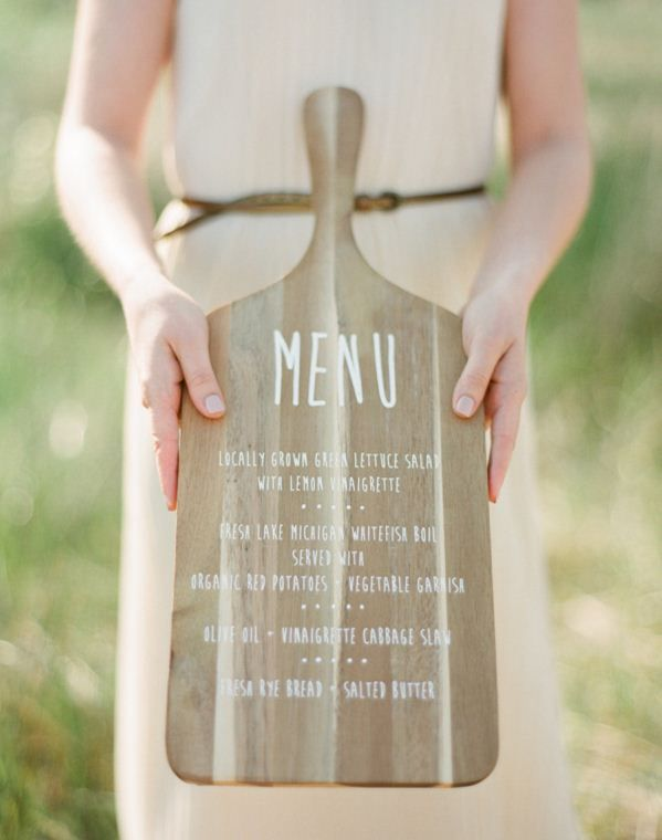 menu written on large cutting board, maybe attach a printed version of menu to cutting board so can use board after wedding?