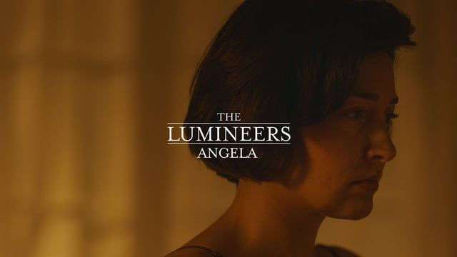 """""""Angela"""" by The Lumineers. From the album Cleopatra, courtesy of Dualtone Records and Decca Records, 2016    Starring: Bethany Toews    Featuring: Elise Eberle, Adam Lively, Gwynn Lewis, Ben Harjo, and The Lumineers    Director: Isaac Ravishankara    Executive Producer: Jason Cole, Danielle Hinde    Prod. Co: Doomsday Entertainment    *    1st Unit (Narrative / Los Angeles)    Producer: Natasha Pierson    1st Assistant Director: Zachary Wright    Director of Photography: Kevin Phillips…"""