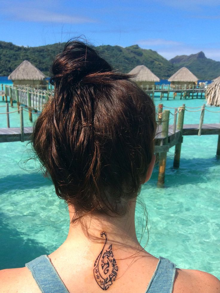 Polynesian Tribal Tattoo in Tahiti. Fish hook design for safe passage over water, with symbols inside: sea turtle (travel/longevity), manta ray (wisdom/peace), Marquesan cross (four elements/harmony) and shark teeth (strength).