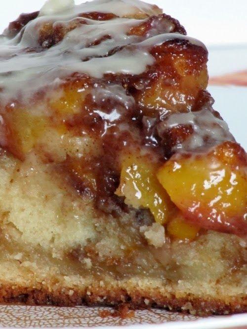 Vanilla Peach Coffee Cake. Vanilla & sour cream cake. Fresh peach & cinnamon topping. Vanilla Icing.