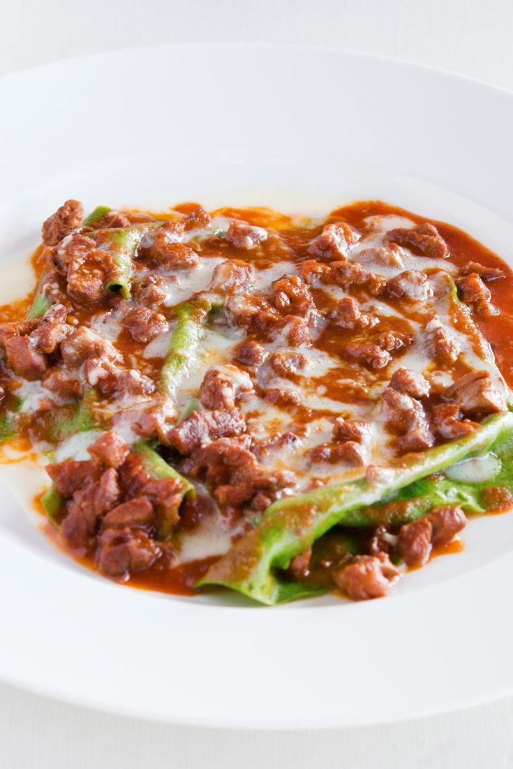 Lasagne is a classic comfort food. Luigi Sartini shares his open beef lasagne recipe which he layers with sheets of verdant spinach pasta and a hearty meat ragù and rich cheese sauce.