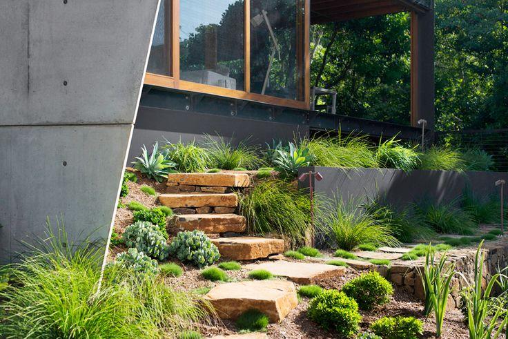 Local rock used to provide access through a terraced garden