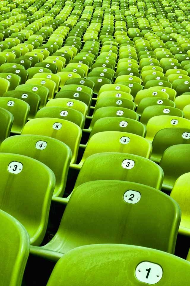 Green seats in Olympiastadion, the stadium located at the heart of the Olympiapark, Munich, Germany. The stadium was built as the main venue for the 1972 Summer Olympics.