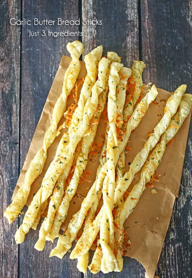 Garlic Butter Bread Sticks - Light puff pastry coated in homemade garlic butter makes these Italian Garlic Butter Bread Sticks the perfect side dish to serve at all your family dinners. on kleinworthco.com