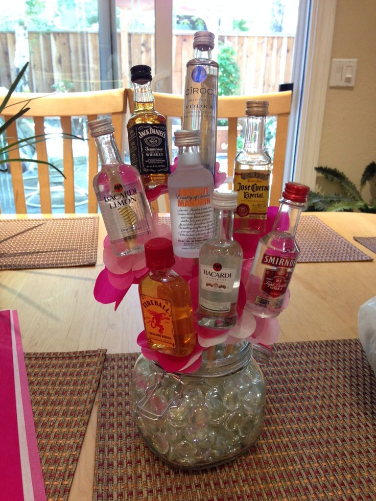 Alcohol Bouquet for the birthday girl - mini alcohol bottles hot glued onto long sticks with tissue paper flowers