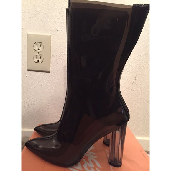 Clear Black Latex boots size 8 Never worn clear black latex boots Shoes Heeled Boots