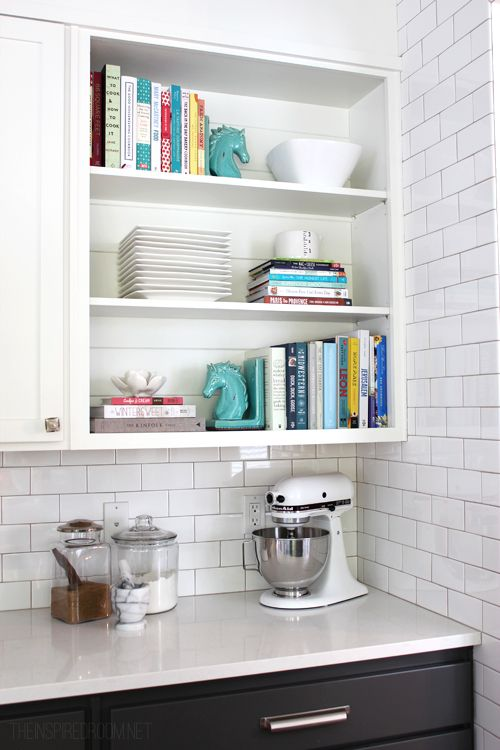 Take doors off a cabinet in the kitchen for cook books and serve ware.: