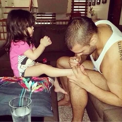 Dad painting her toe nails ... love  <3