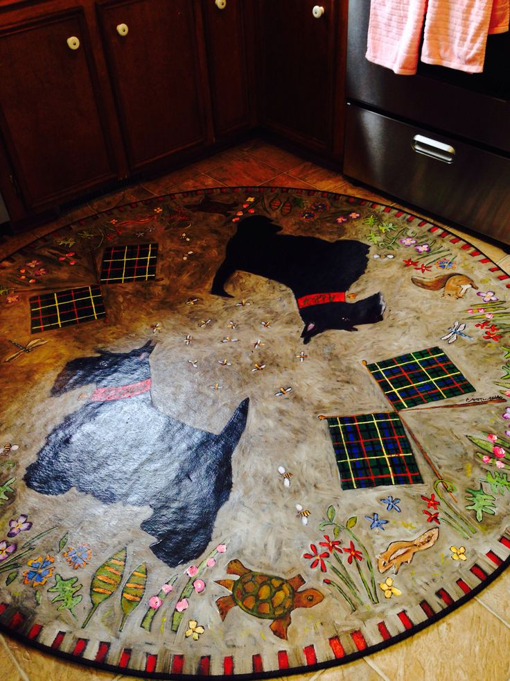 """""""Scottie dogs, squirrels , chipmunks and flowers"""" circle floorcloth in the kitchen."""