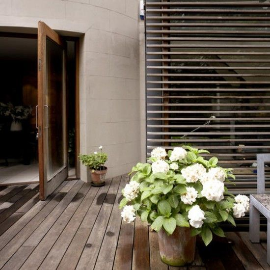 Modern garden decking    Decking gives this outdoor space a contemporary feel, while a potted plant adds a welcome touch of colour.    Similar decking  Timeless Timber
