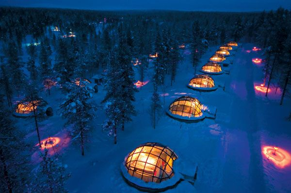 Enjoy the snow sights and northern lights under the glass ceiling at room temperature. Hotel Kakslauttanen, Finland