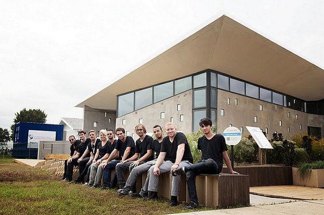 NJIT students sitting in front of ENJOY house by ENJOY House - Team NJ, Solar Decathlon 2011, via Flickr
