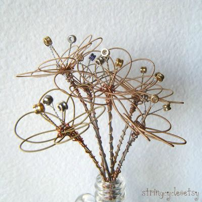 Our friend made us a fabulous Floral Centerpieces from Used Guitar Strings. Here's more wonderful ideas | Candoodles