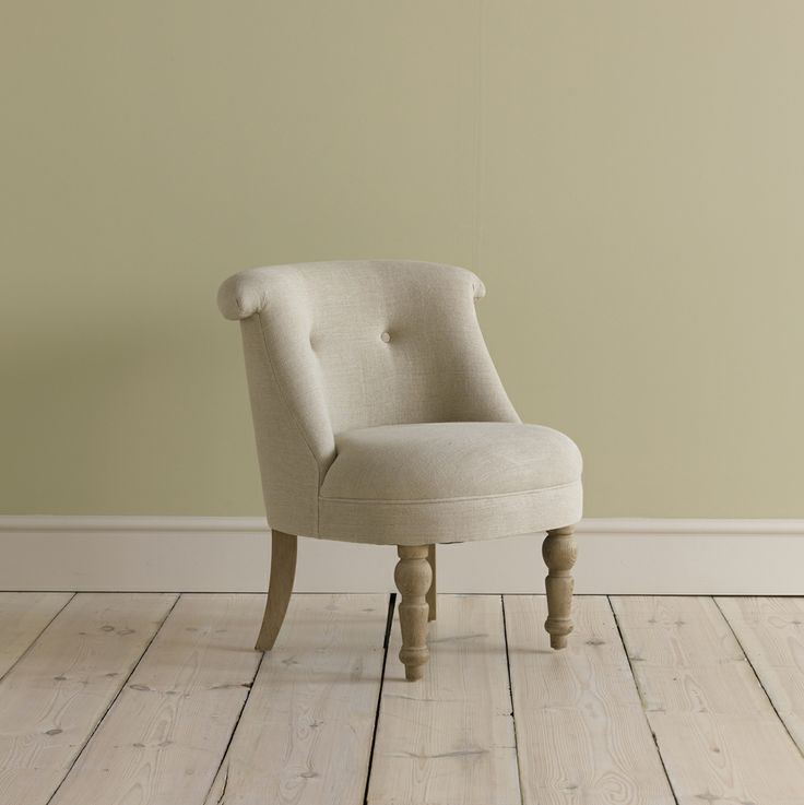 BOVARY. Handmade in Nottingham and covered in a lovely natural linen fabric which we buy from a Lancashire mill. What makes this chair even more special are the solid oak legs which undergo one hell of a rub to give them a gorgeous weathered finish. Mwah!