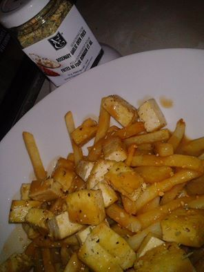 Vegan Poutine my way ! Fried Salty tofu, homemade vegan gravy with thyme and rosemary and fries