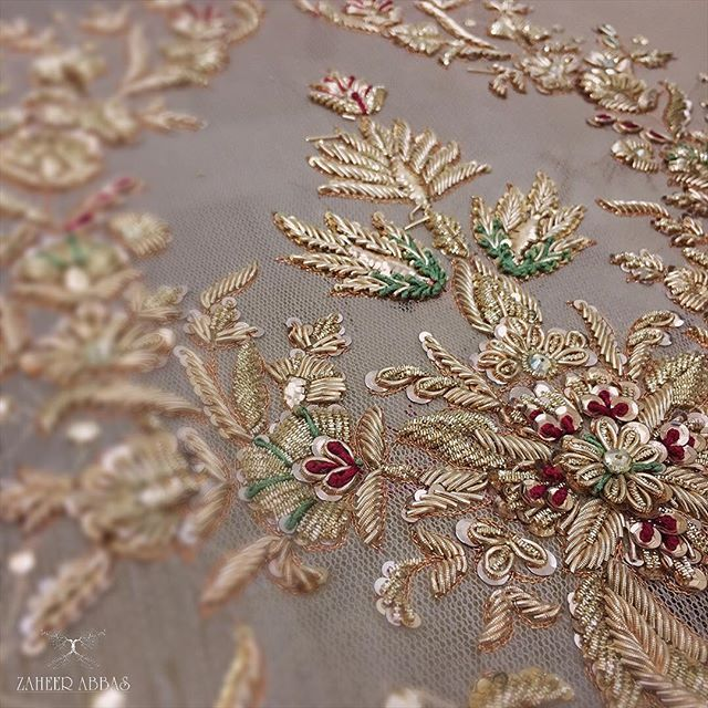 "Zardosi literally means ""sewing with gold"" and is originally a Persian art form. It involves creating designs with gold, silver and colorful metal threads. The effect of this embroidery is enhanced by the use of sequins, stones, glass and metallic beads, brocades and motifs."