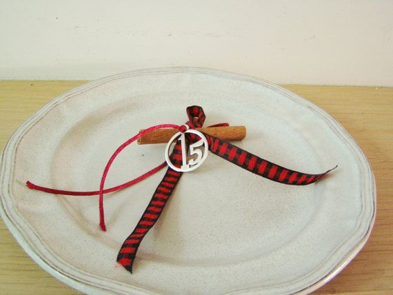 2015 New Years good luck charm is a New Years charm-ornament that I made with red ribbons and a cinammon stic.It is a lovely, small, holiday