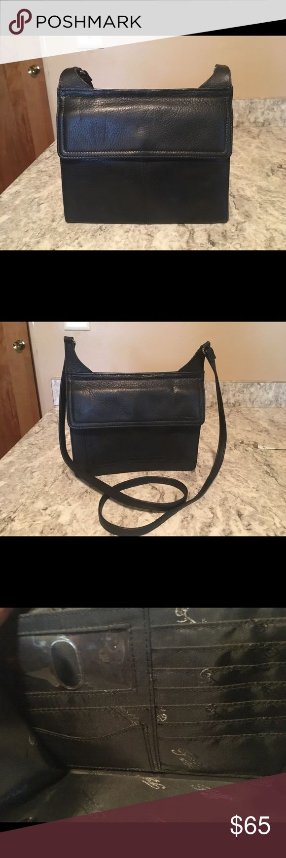 Fossil Bag. Class Black Leather Crossbody. Used but in Great Condition. 8 W x 7 L. Drop Inch 23. Spacious Front and Back Snap Closure. Several Card Slots and ID Slot. Fossil Bags Crossbody Bags