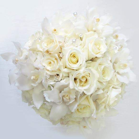 a beautiful bridal bouquet consisted of white roses and orchids