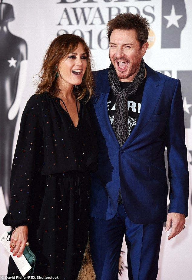Going strong:Yasmin Le Bon, 51, and her husband Simon, 57, proved that they were still as loved-up as ever as they put on an amorous display at the 2016 BRIT Awards at the O2 arena on Wednesday evening