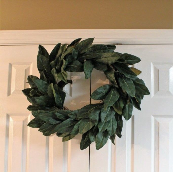 Magnolia leaf wreath decorations with a magnolia wreath mirror  fireplace mantel decorations. DIY Magnolia leaf wreath