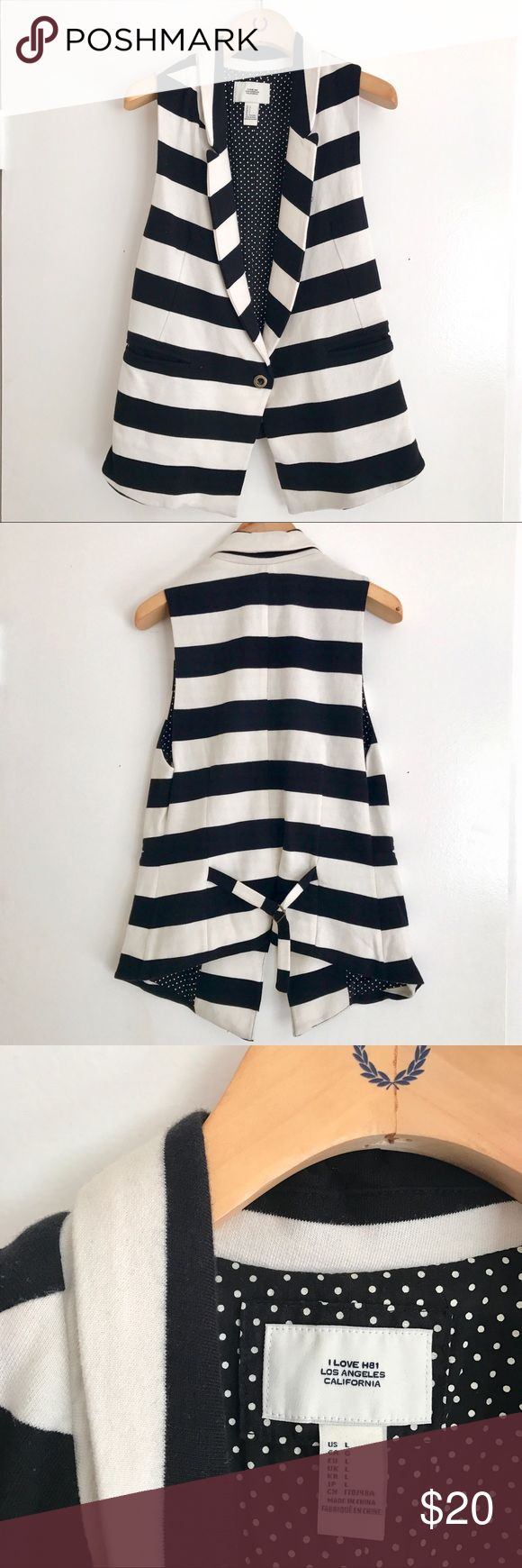 Black and White Striped Vest Size Large - Black and White Striped Vest, with cute polkadot lining! One button closure in front. There is a small mark as seen in picture, not very noticeable, it may come out in the wash. Feel free to ask questions! Jackets & Coats Vests