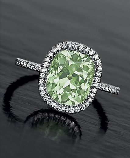 Set with an old-mine cut fancy yellowish green diamond, 2.49 carats, within a single-cut diamond surround, to the single-cut diamond gallery and hoop, mounted in platinum, size 2¼ By JAR
