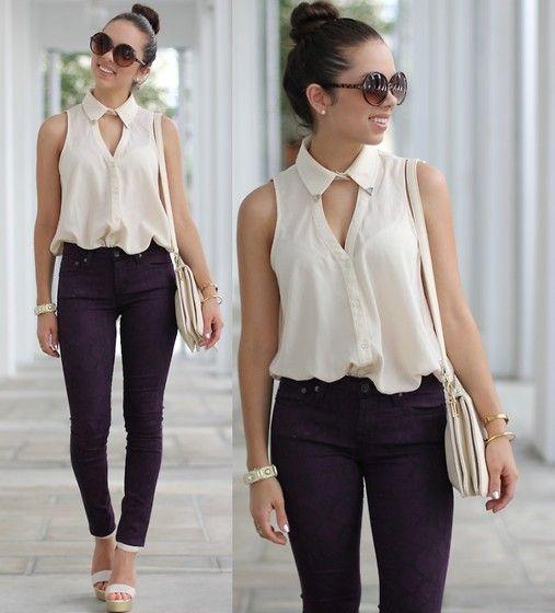 Key hole sleeveless blouse, black jeans, round sunglasses