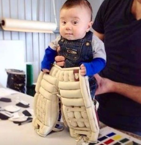 Goalie in training... tiniest goalie pads ever!
