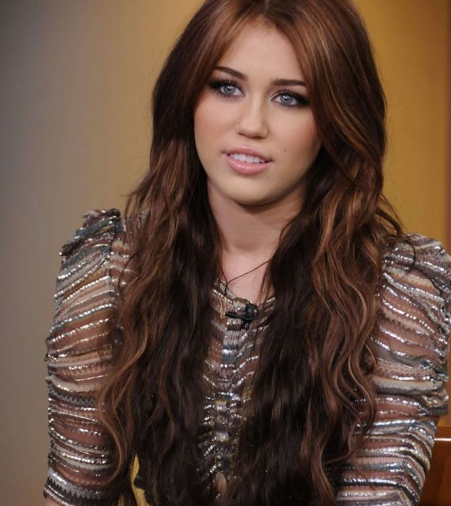 Miley Cyrus Hairstyle. Have it. Long cute. Dark and light brown hair.