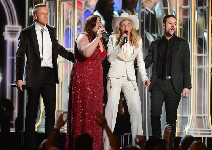 Wearing an all-white getup, Madonna helped to serenade along with Macklemore and Mary Lambert during a touching performance at the 2014 Grammys.