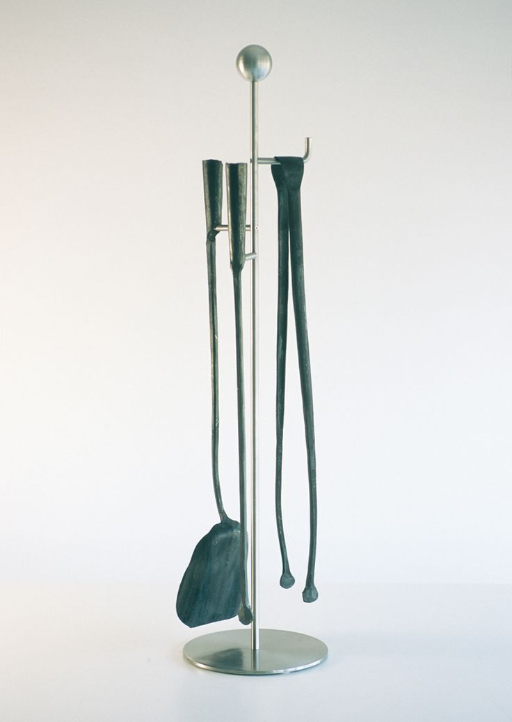 Series of hand-forged iron implements for the fireplace. Made in a workshop of yesteryear using a five-hundred-year-old water-driven hammer. Each implement is obtained from recycled iron, and cut and refashioned old rail tracks: unique pieces that express matter, energy and strength.