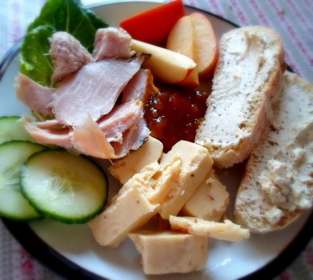 "Ploughman's Lunch Picnic Supper.   "" . . .  Crusty bread, some nice pickle/chutney, a couple of good cheeses, some fruit (apple in this case), a bit of veg (cucumber and lettuce on this occasion) and some chunky bits of ham.""   / The English Kitchen"